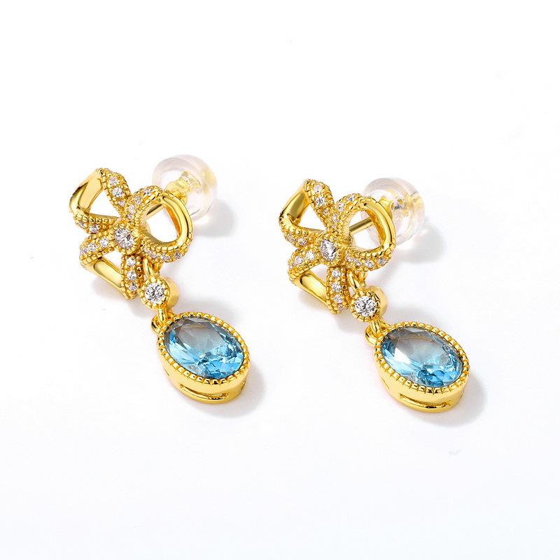 Bowknot blue zircon sterling silver stud earrings