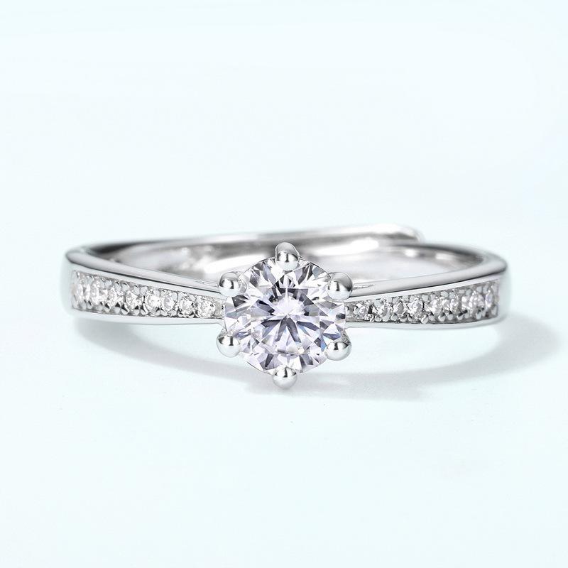 Elegant prong set moissanite sterling silver engagement ring