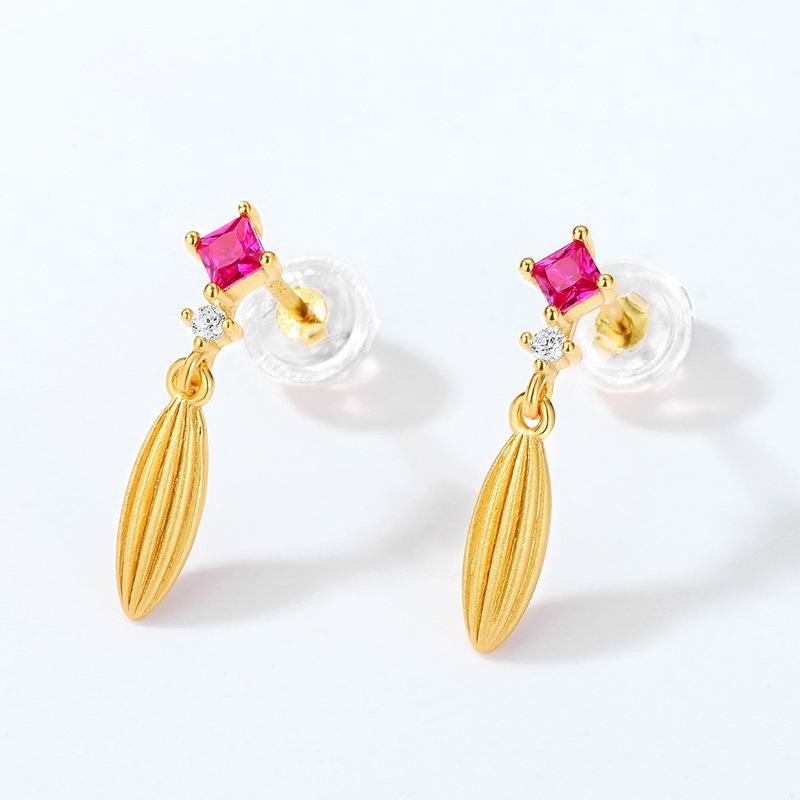 Grain shape sterling silver stud earrings in 9K gold vermeil
