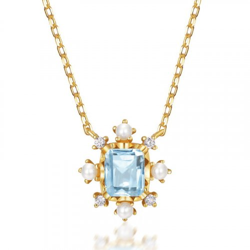 Blue topaz & pearl snowflake necklace