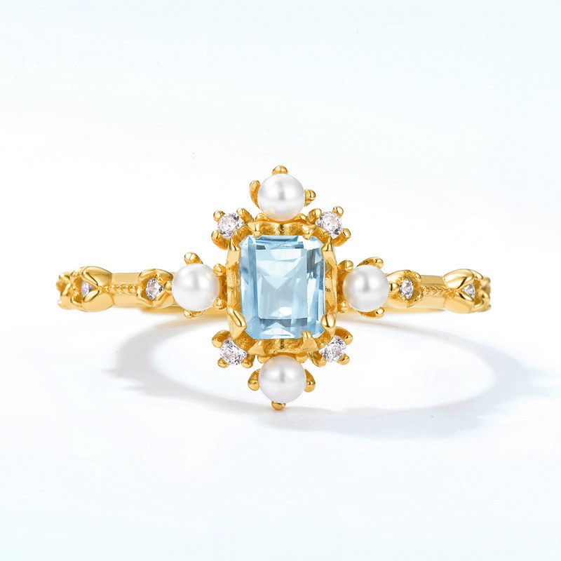 Snowflake silver topaz pearl ring